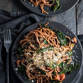 Drunken Red Wine Spaghetti is pasta cooked in red wine so it soaks up the pretty color and the natural sweetness and flavor of the wine. It's a super easy dinner recipe yet impressive enough for a special meal. | theendlessmeal.com