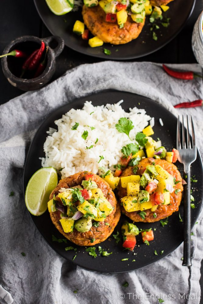 These delicious Thai Fish Cakes are bursting with flavor. The salmon is cooked in coconut milk and Thai spices then cooled and formed into patties. A quick sear in coconut oil makes the edges crispy and leaves the inside super tender. Top them with the fruit salsa for a simple yet totally tasty dinner recipe that is naturally paleo + gluten-free. | theendlessmeal.com