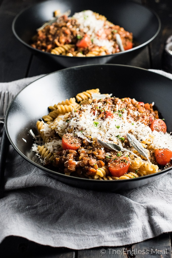I promise you won't miss the meat in this delicious Lentil Bolognese. By caramelizing the onions, carrots, peppers, and tomato paste the pasta sauce becomes rich and deeply flavored. It's an easy to make and delicious vegan dinner recipe. | theendlessmeal.com