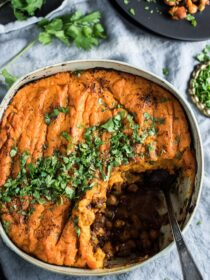 Vegan Shepherd's Pie has tons of flavor thanks to curry spices and caramelized tomato paste. It's loaded with veggies, lentils, and chickpeas and topped with coconut mashed sweet potatoes. It's a vegan dinner recipe that is as healthy as it is delicious. | theendlessmeal.com