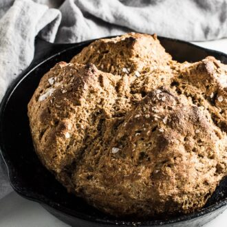 Whole Wheat Irish Soda Bread is a breeze to make and so delicious. If you have 5 minutes to spare you can whip up a batch and sit back while it bakes and fills your house with the smell of fresh baked bread. | theendlessmeal.com