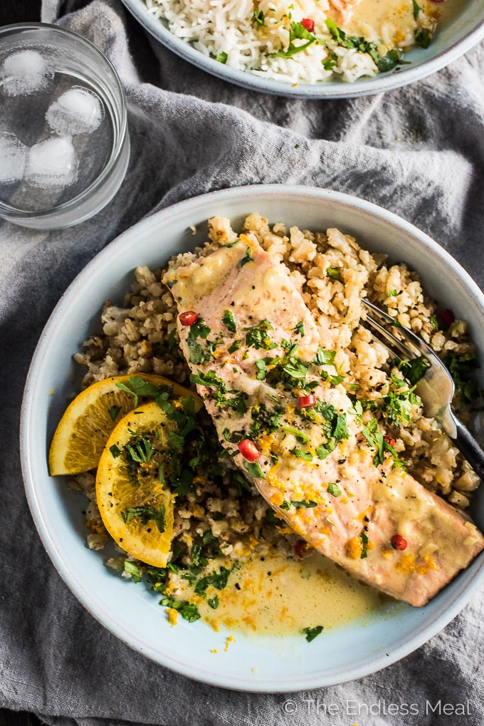 Coconut Orange Poached Salmon is my absolute favorite fish recipe and one I've been making for years. The gentle orange flavor and the creamy coconut were meant for each other and make a delicious sauce that is perfect for pouring over rice or cauliflower rice. A secret trick keeps the salmon super tender. This healthy dinner recipe is gluten-free + paleo + Whole30 approved. | theendlessmeal.com