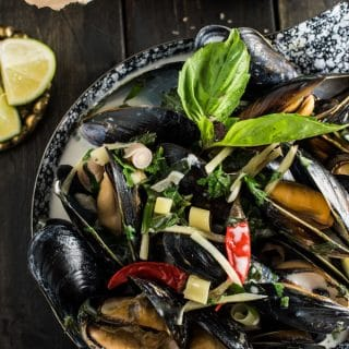 These juicy Coconut Thai Mussels are quickly cooked in coconut milk and flavorful Thai spices. Dinner doesn't get any easier than this delicious recipe. I love to serve some crispy baked fries on the side for a Thai-fusion Moules Frites. Gluten-free + paleo + Whole30 approved.   theendlessmeal.com
