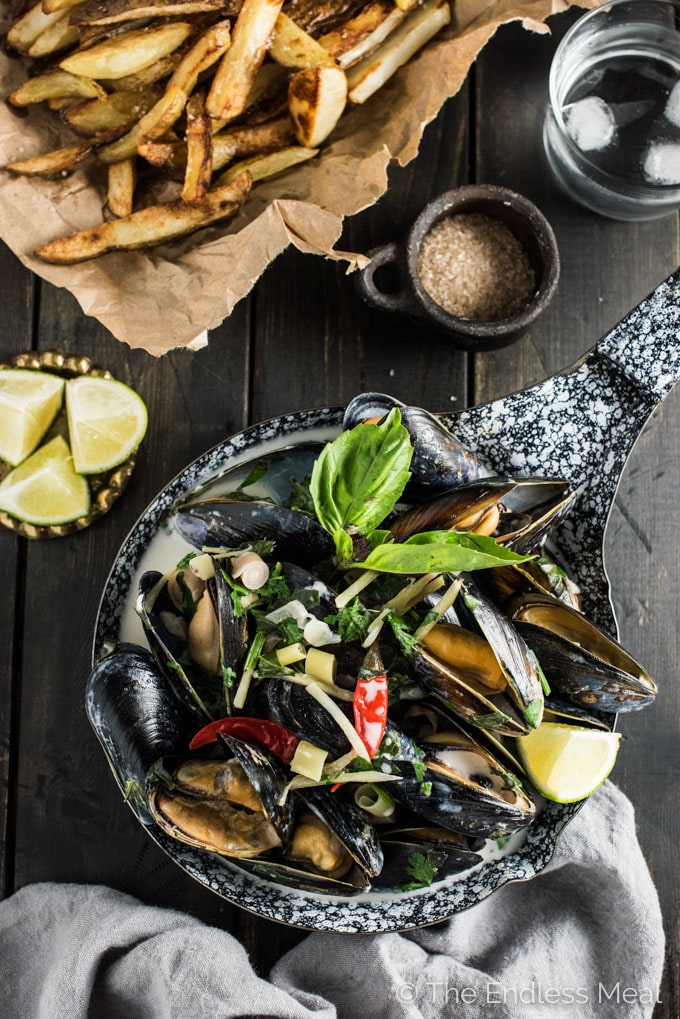These juicy Thai Coconut Mussels are quickly cooked in coconut milk and flavorful Thai spices. Dinner doesn't get any easier than this delicious recipe. I love to serve some crispy baked fries on the side for a Thai-fusion Moules Frites. Gluten-free + paleo + Whole30 approved. | theendlessmeal.com