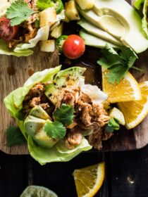 These super easy to make Crock Pot Chicken Taco Boats are perfect for a healthy Mexican fiesta. The shredded chicken is smothered in a delicious chipotle, orange, and pineapple sauce and heaped inside crunchy lettuce wraps. | theendlessmeal.com