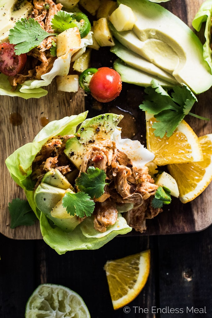 These super easy to make Crock Pot Chicken Taco Lettuce Boats are perfect for a healthy Mexican fiesta. The shredded chicken is smothered in a delicious chipotle, orange, and pineapple sauce and heaped inside crunchy lettuce wraps. | theendlessmeal.com