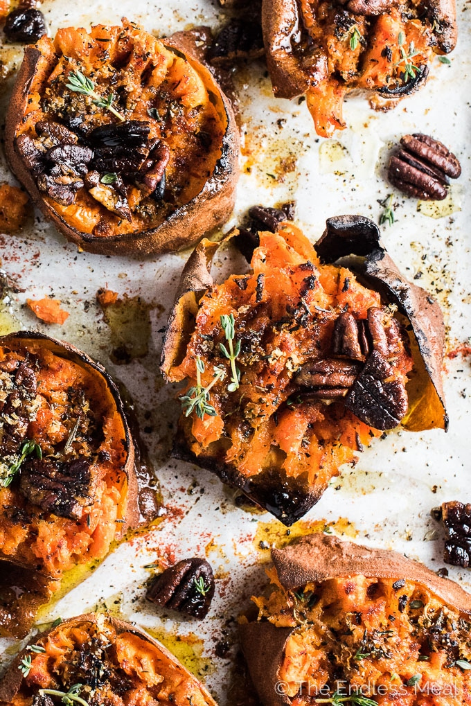 These easy to make Herb and Garlic Smashed Sweet Potatoes are insanely delicious. They make the perfect sweet and savory healthy side dish for a weekend supper or Easter dinner. They're also naturally 100% gluten-free, paleo, Whole30 and can easily be made vegan. Win! | theendlessmeal.com