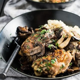 This crispy skinned, Pan Fried Chicken and Mushrooms is the ultimate feel-good comfort food. The chicken is seared in a skillet with loads of mushrooms then served over an easy to make cauliflower mash. It's a healthy dinner recipe that is so delicious. It's also naturally dairy free + paleo + low carb + Whole30 compliant. | theendlessmeal.com