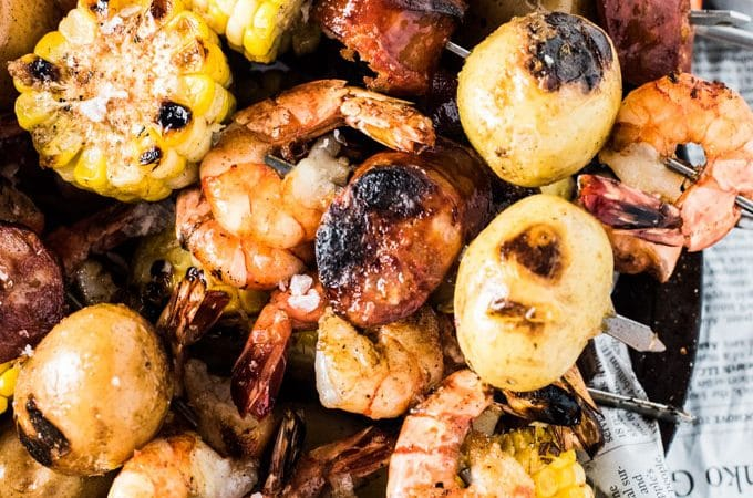 These easy to make Cajun Shrimp Boil Skewers are INSANELY delicious. The Cajun lemon garlic butter dip takes them over the top. They're also a healthy summer BBQ recipe that is naturally gluten-free. Go ahead, dig in! | theendlessmeal.com