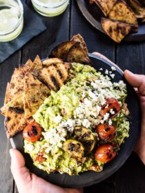 Step up your guac game with this DELICIOUS Chunky Grilled Guacamole. The subtle smoky flavor of the grilled veggies really kicks up this easy party appetizer. Big Bonus: this healthy recipe is gluten-free + paleo and can easily be made vegan + Whole30 compliant.  | theendlessmeal.com