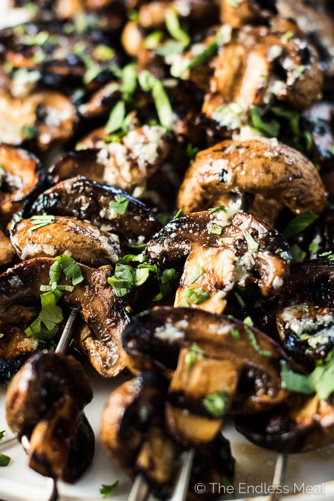 Grilled Garlic Butter Mushrooms are a super easy to make, healthy, and delicious summer BBQ recipe. They make the perfect side dish recipe or vegan main. Make them paleo + Whole30 with a simple substitute. | theendlessmeal.com