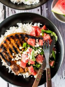 Grilled Gochujang Pork Chops are a delicious and healthy summer BBQ recipe. They are marinated in a sweet and spicy Korean chili paste then grilled to perfection. Serve them with a side of rice (or cauliflower rice!) and a simple mint watermelon salad for an easy and healthy dinner recipe. | theendlessmeal.com