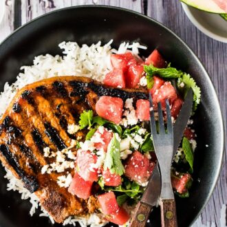 Grilled Gochujang Pork Chops are a delicious and healthy summer BBQ recipe.They are marinated in a sweet and spicy Korean chili paste then grilled to perfection. Serve them with a side of rice (or cauliflower rice!) and a simple mint watermelon salad for an easy and healthy dinner recipe.| theendlessmeal.com