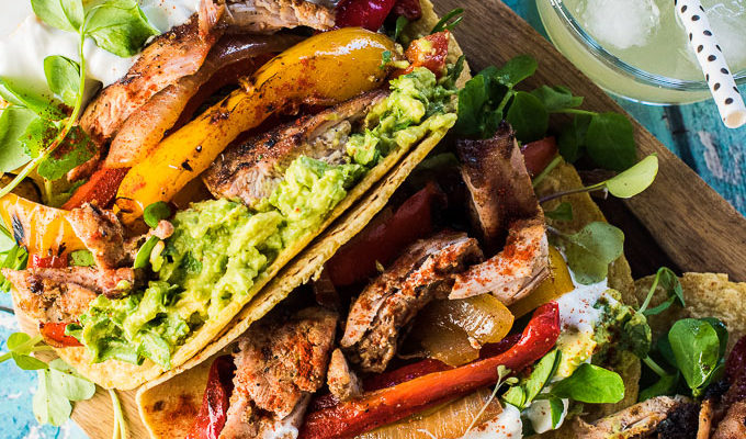 These crazy delicious MezcalChicken Fajitas are made by marinating chicken in smoky mezcal then grilling them and a bunch of veggies. They're a super easy to make and healthy summer BBQ recipe. You will LOVE them! | theendlessmeal.com
