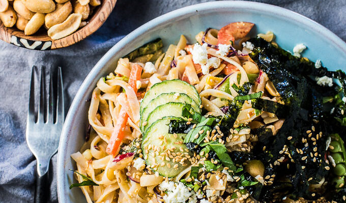 This healthy Thai Noodle Salad recipe is smothered in a crazy delicious feta peanut dressing and loaded with fresh summer veggies. It's an easy to make vegetarian main or side dish that can be served hot or cold. You will LOVE it!   theendlessmeal.com