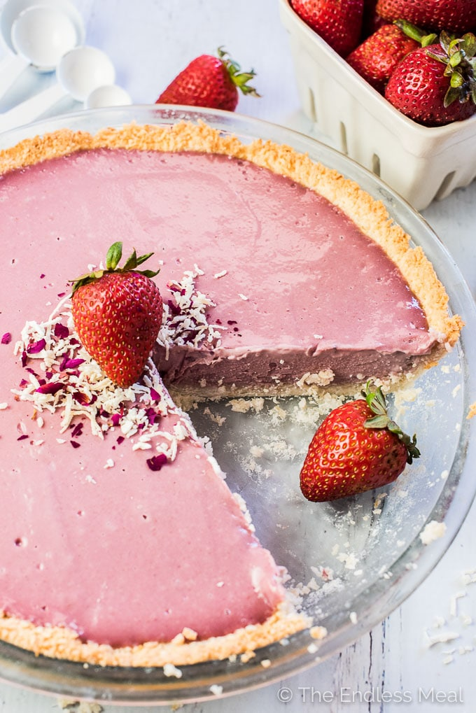 This pretty pink Vegan Strawberry Cream Pie is as delicious as it gets. It's made with creamy strawberry cashew custard and a coconut crust. It's a naturally dairy-free + gluten-free + paleo dessert recipe that everyone will LOVE!  | theendlessmeal.com