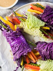 These super colorful Veggie Rainbow Wraps are served with an easy to make peanut dipping sauce and are as delicious as they are healthy. They're a playful way to serve a veggie tray at a party and make an easy and healthy afternoon snack. They're naturally vegan + gluten-free and can be made paleo + Whole30 compliant if you use almond butter. Win! | theendlessmeal.com