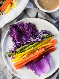 These super colorful VeggieRainbow Wraps are served with an easy to make peanut dipping sauce and are as delicious as they are healthy. They're a playful way to serve a veggie tray at a party and make an easy and healthy afternoon snack. They'renaturally vegan + gluten-free and can be made paleo + Whole30 compliant if you use almond butter. Win! | theendlessmeal.com