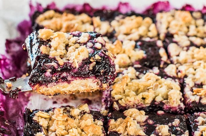 These delicious Blueberry Jam Bars are like a blueberry crumble or blueberry crisp made into little bars. They are made with an oatmeal crust and loaded with fresh blueberries. It's a healthier dessert recipe that can easily be made vegan + gluten-free + refined grain free.  | theendlessmeal.com