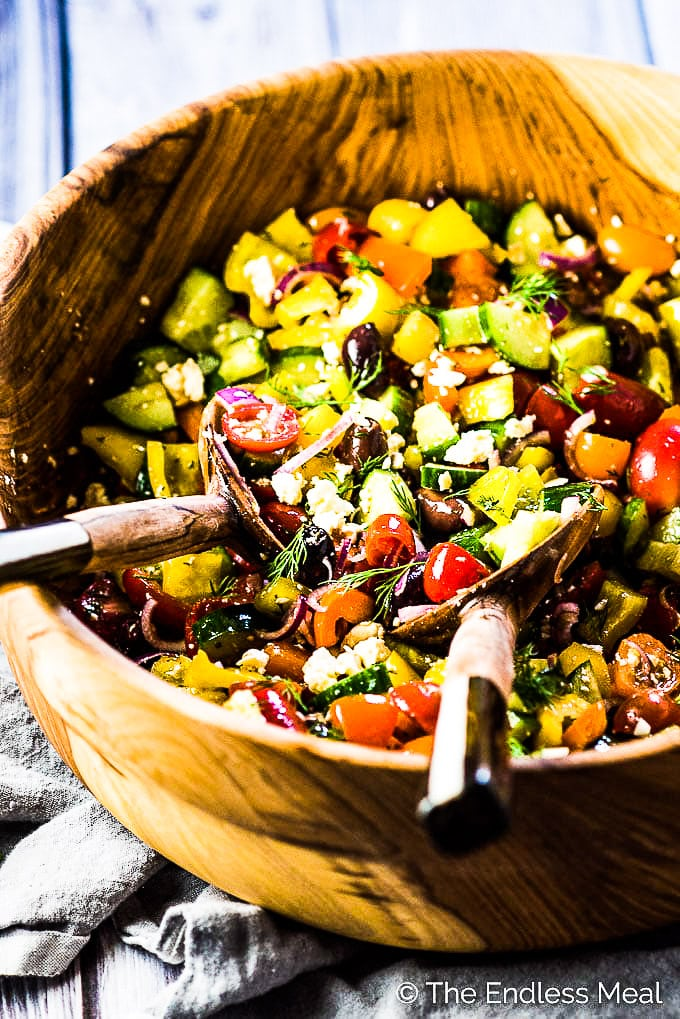 The best Greek salad recipe in a wooden bowl.