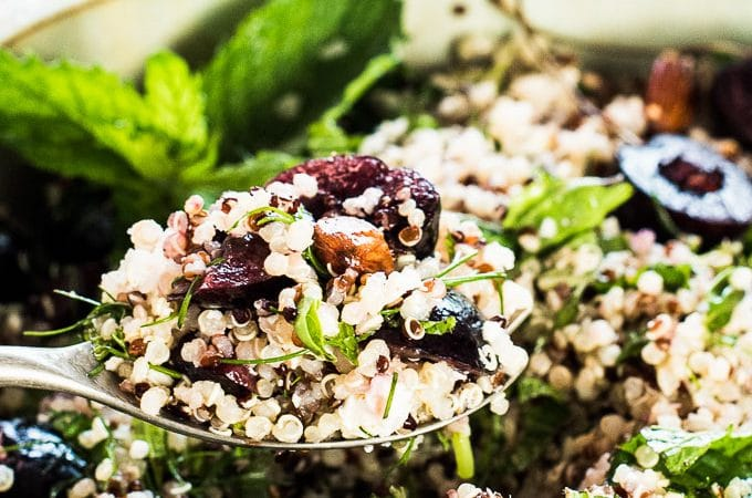 This light and fresh Summer Quinoa Salad is perfect for a hot sunny day or dinner on the patio. It's loaded with sweet cherries, toasted almonds, feta cheese, and fresh herbs and tossed with a lemony dressing. Leftovers make a healthy and delicious lunch. It's a healthy vegetarian + gluten-free side dish that can easily be made vegan, too.  | theendlessmeal.com