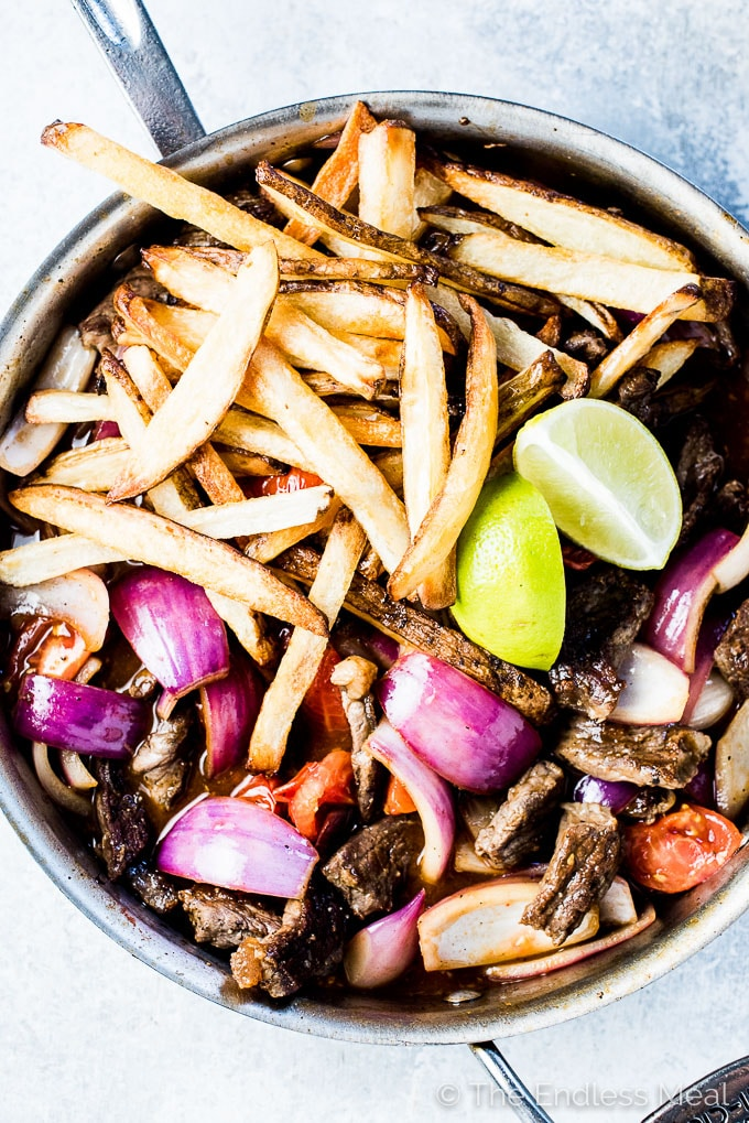 If you haven't had Lomo Saltado before, you're in for a real treat. As strange as it sounds, it's a Peruvian Steak and French Fry Stir Fry and it's absolutely delicious. It's a simple to make and healthy dinner recipe that can easily be adapted to make it gluten-free + paleo + Whole30 compliant.  | theendlessmeal.com