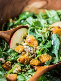 I've been making this Roasted Pumpkin Spinach Salad for years now, and it is still one of my favorite autumn salad recipes. It is easy to make, healthy, and the pumpkin maple dressing is to die for. It is a vegetarian recipe that can easily be made vegan + paleo.  | theendlessmeal.com