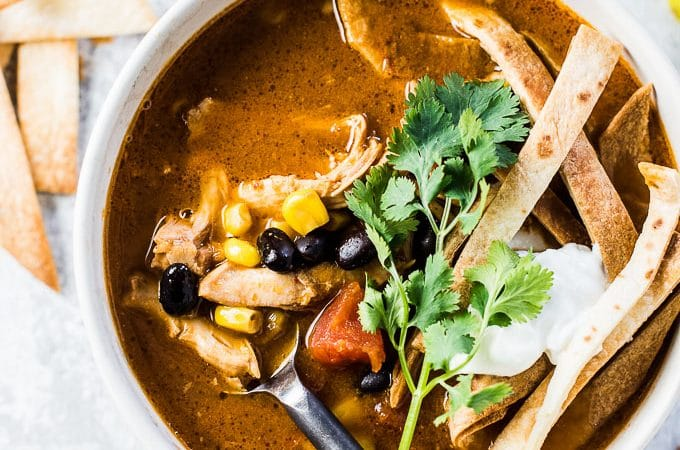 I've been told by everyone who's had this recipe that it's literally The Best Crock Pot Chicken Tortilla Soup ever. I use a couple easy tricks to maximize the flavor while keeping the prep time down. It's a healthy and delicious slow cooker Mexican recipe that's a true crowd pleaser. | theendlessmeal.com