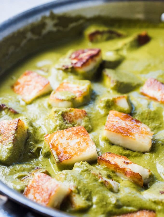 If you're looking for an Easy Palak Paneer recipe that is crazy delicious, this is it. It's bursting with flavor and bright green color and dotted with tasty pan-seared paneer. It's a healthy, weeknight dinner recipe that's naturally vegetarian and gluten-free and can easily be made vegan by using tofu instead of paneer. | theendlessmeal.com