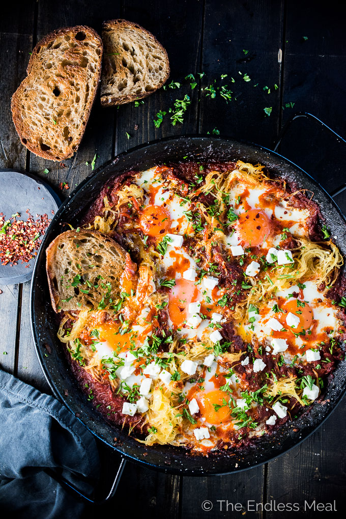 Eggs in Purgatory is a simple and super healthy recipe that is crazy delicious. Eggs are nestled into a rich tomato sauce with lots of spaghetti squash then baked to perfection. It's a naturally vegetarian + gluten-free + paleo + Whole30 recipe that everyone will love. | theendlessmeal.com | |#breakfast #eggs #eggrecipes #healthybreakfast #whole30 #paleo #halloween #spaghettisquash