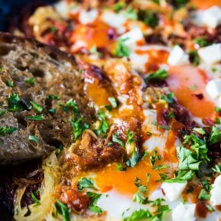 Eggs in Purgatory is a simple and super healthy recipe that is crazy delicious. Eggs are nestled into a rich tomato sauce with lots of spaghetti squash then baked to perfection. It's a naturally vegetarian + gluten-free + paleo + Whole30 recipe that everyone will love. | theendlessmeal.com