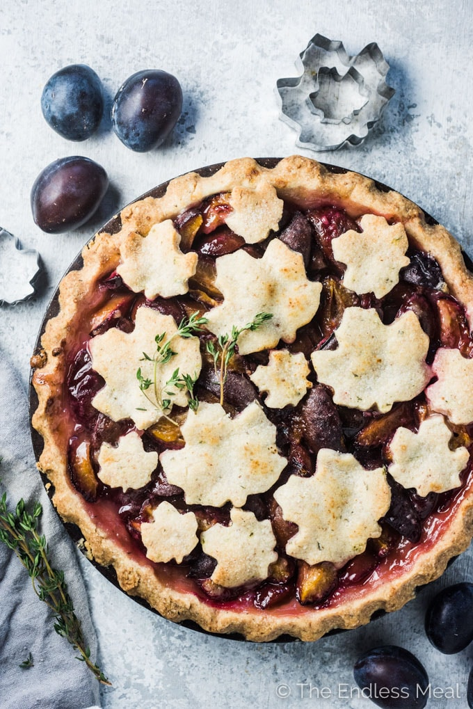 Prune Plum Pie is one of my all-time favorites. It's both tart and sweet and reminiscent of a strawberry rhubarb pie. The tasty Italian plums sit in an easy to make flaky pastry that's gently flavored with almond flour and thyme. This is one dessert recipe you're not going to want to miss! | theendlessmeal.com