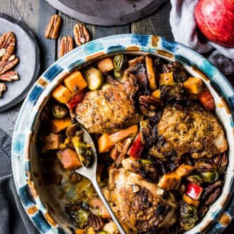This delicious Bacon Apple Chicken is the perfect fall dinner recipe. The bacon and chicken are crisped on your stove top then everything gets nestled into a baking dish and roasted together. It's a healthy and easy to make recipe that is bursting with flavor. It's also gluten-free + paleo + Whole30 compliant. | theendlessmeal.com