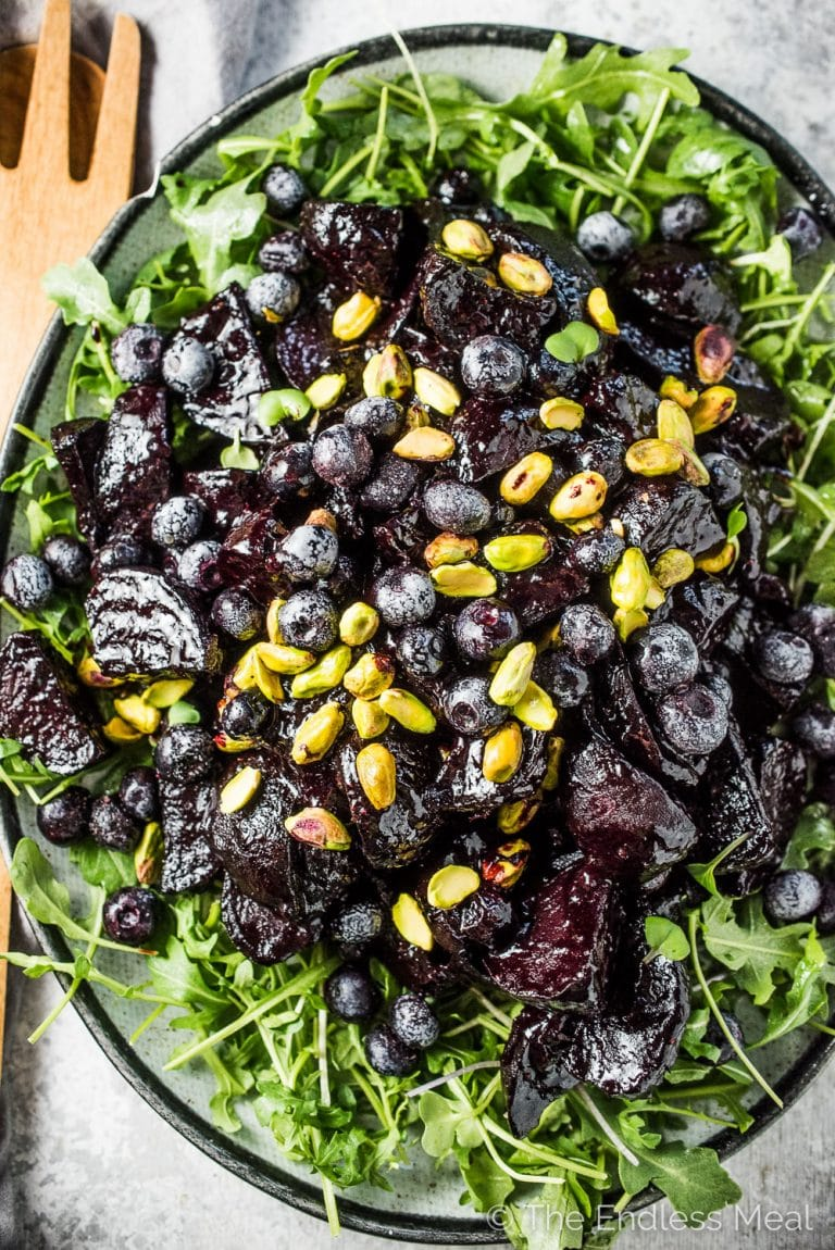 These insanely delicious Blueberry Balsamic Glazed Beets are a must for your Thanksgiving or Christmas table. Or heck, all winter long. The beets are roasted then coated in a sugar-free, sticky glaze made with frozen blueberries and balsamic vinegar. This healthy side dish recipe is also gluten-free + paleo + Whole30 compliant! | theendlessmeal.com | #blueberries #beets #thanksgiving #christmas #ThanksgivingRecipes #whole30 #paleo #sugarfree #bcblueberries