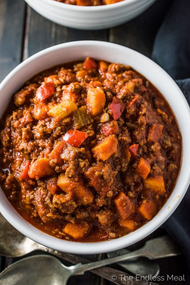 This delicious bean free Easy Paleo Chili Recipe has become our family's go-to one pot dinner. It's full of healthy veggies and so simple to make. It's also 100% Whole30 compliant. You're going to LOVE it! | theendlessmeal.com | #chili #paleochili #whole30chili #beanfreechili #whole30recipes #paleorecipes #paleofamilyrecipes #healthychili #easychilirecipe #chilirecipe #healthyrecipes #beanlesschili #beanlesschilirecipe