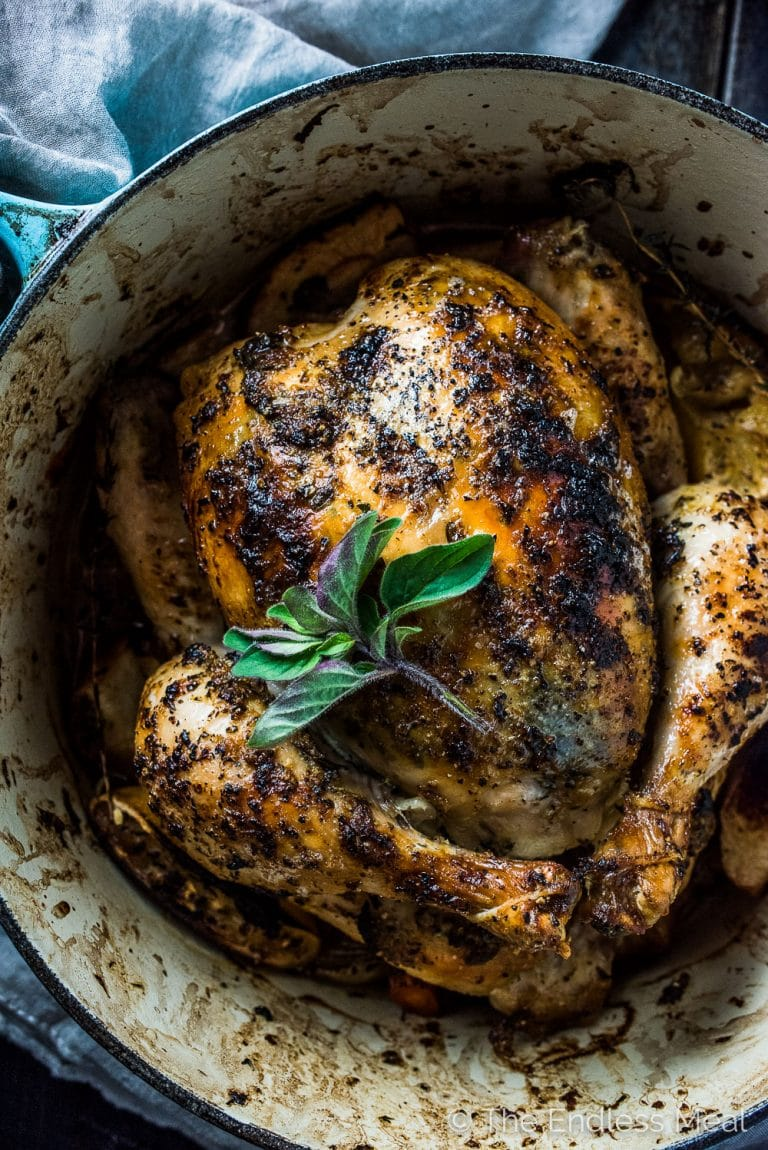 Lemon Herb Butter Roasted Chicken is insanely delicious and a foolproof roast chicken recipe. The lemon herb butter keeps the chicken so tender while crisping the skin perfectly. It's a healthy and easy to make recipe that's naturally gluten-free + paleo and can easily be made Whole30 compliant. | theendlessmeal.com