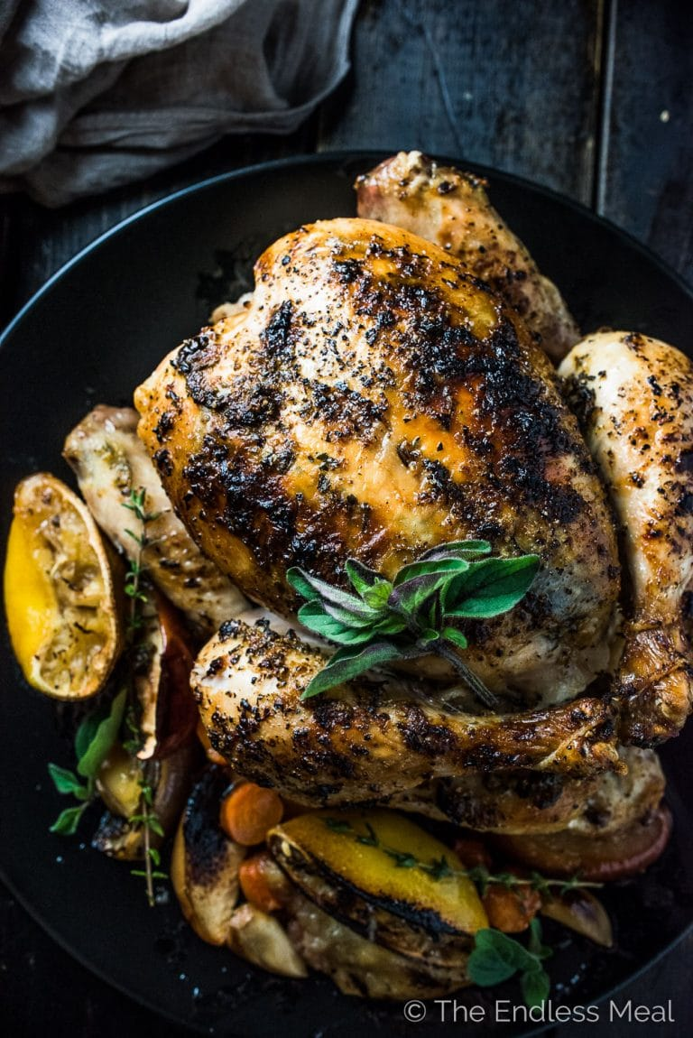 Lemon Herb Butter Roast Chicken is insanely delicious and a foolproof roast chicken recipe. The lemon herb butter keeps the chicken so tender while crisping the skin perfectly. It's a healthy and easy to make recipe that's naturally gluten-free + paleo and can easily be made Whole30 compliant. | theendlessmeal.com | #roastchicken #chicken #roastedchicken #thanksgiving #whole30 #paleo #ThanksgivingRecipes