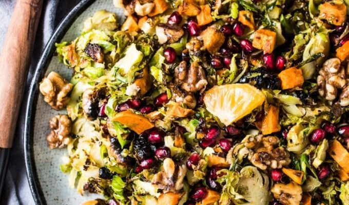 This delicious Shaved Brussels Sprout Salad has all of your favorite autumn flavors. The Brussels are first roasted and then tossed in an orange lemon vinaigrette. You'll find sweet potatoes, toasted walnuts, mandarin oranges, and pomegranate all hiding in this healthy and delicious side dish. It would be perfect on your Thanksgiving or Christmas table and delicious all winter long. Whole30 + paleo + easily made vegan.   theendlessmeal.com