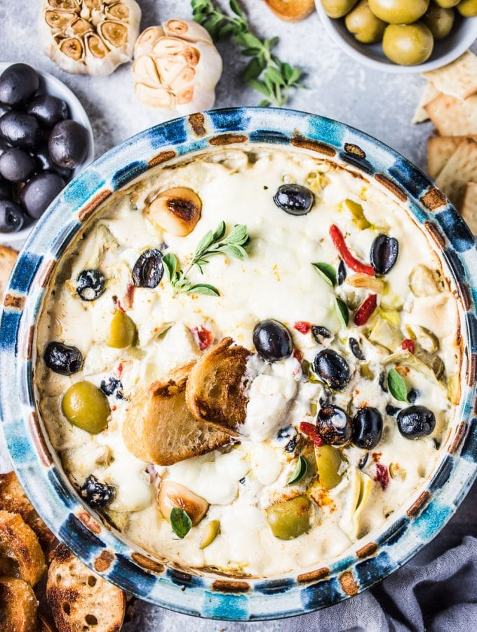 Cheesy Roasted Garlic Artichoke Olive Dip
