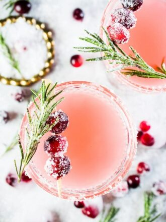 This pretty and delicious Cranberry Margarita is perfect for Christmas parties. Cranberries are muddled with tequila, lime juice, and an easy to make rosemary simple syrup then shaken over ice. If you like margaritas you will love this cocktail! | theendlessmeal.com