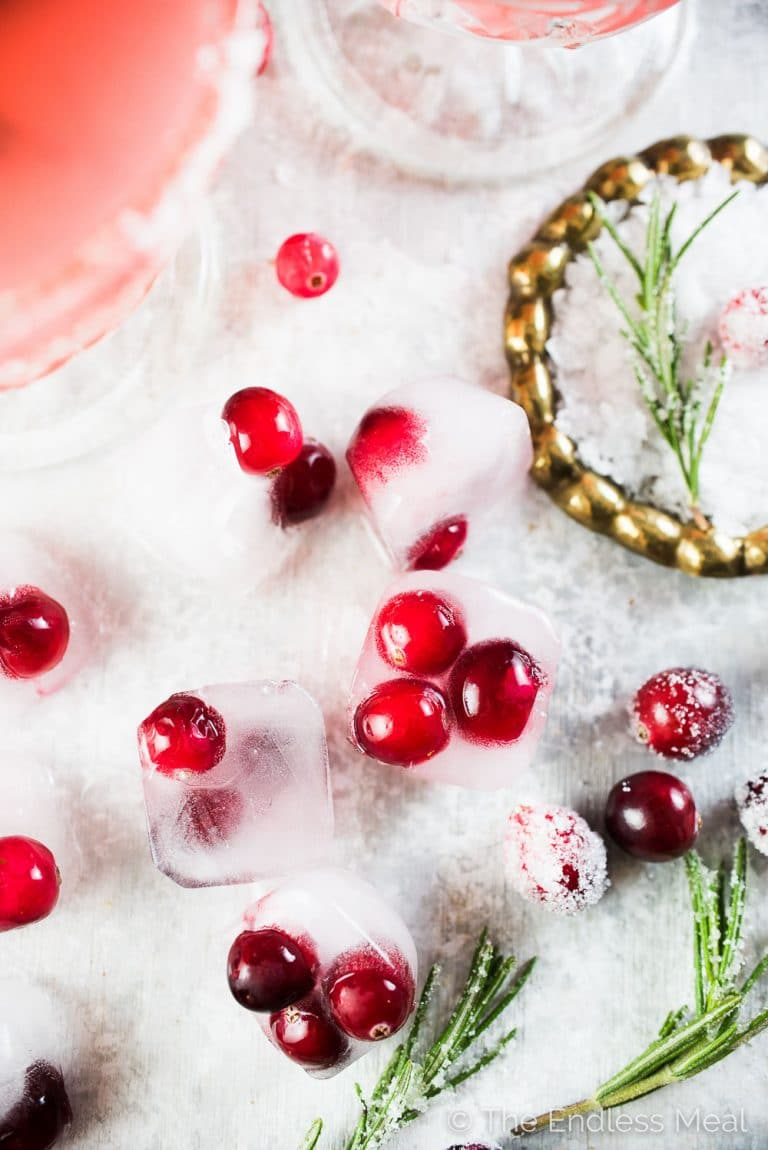 This pretty and delicious Cranberry Margarita is perfect for Christmas parties. Cranberries are muddled with tequila, lime juice, and an easy to make rosemary simple syrup then shaken over ice. If you like margaritas you will love this cocktail! | theendlessmeal.com | #christmas #christmascocktail #christmasrecipes #margarita #cranberry #cocktail