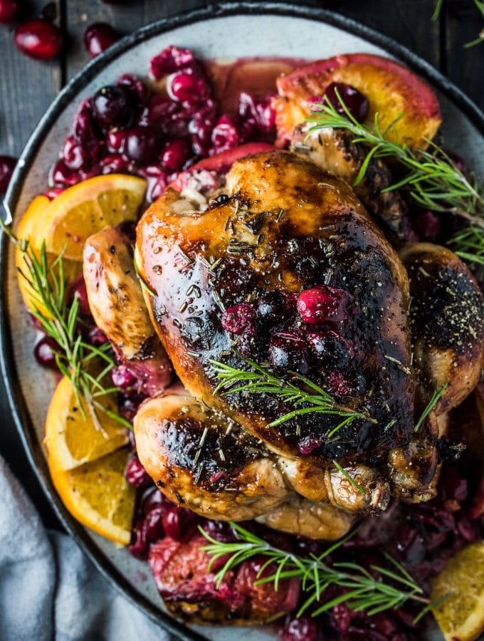 Orange Cranberry Roast Chicken with Rosemary Balsamic Butter
