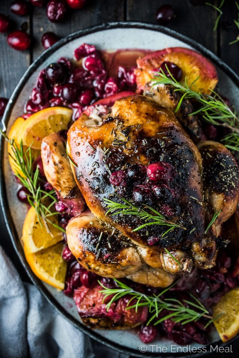 This crazy delicious Orange Cranberry Roast Chicken is covered with rosemary balsamicbutter to keep it tender and juicy. It's a super easy to make and healthy recipe that is as perfect for a weekend dinner as it is for a specialholiday meal. | www.theendlessmeal.com