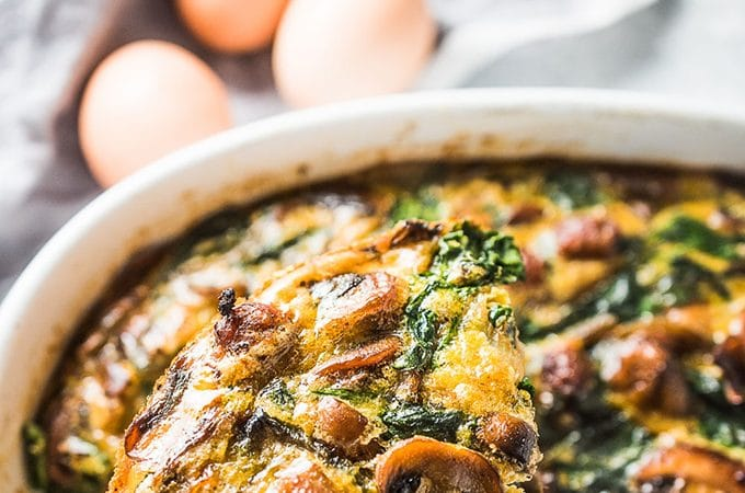 Want a filling and delicious make-ahead breakfast recipe? This easy to make Sausage and Egg Breakfast Bake has your name on it. It's made with a potato and sweet potato crust then loaded with sausages, mushrooms, spinach, and eggs. This healthy brunch recipe is naturally paleo + gluten-free + Whole30 compliant. You will LOVE it! | theendlessmeal.com | #breakfast #brunch #whole30 #paleo #christmasbreakfast #casserole #eggrecipes #eggs #bcegg