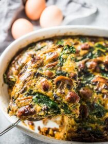 Want a filling and delicious make-ahead breakfast recipe? This easy to make Sausage and Egg Breakfast Bake has your name on it. It's made with a potato and sweet potato crust then loaded with sausages, mushrooms, spinach, and eggs. This healthy brunch recipe is naturally paleo + gluten-free + Whole30 compliant. You will LOVE it! | theendlessmeal.com