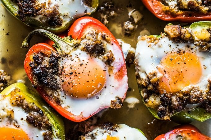 Want an easy and delicious, make-ahead brunch recipe? Try these Egg and Sausage Stuffed Peppers. They are amazing. The bell peppers are first stuffed with an onion, potato, and sausage hash. Crack an egg into the hash and bake them in your oven and breakfast is ready. They're a healthy gluten-free + paleo + Whole30 recipe you will love! | theendlessmeal.com