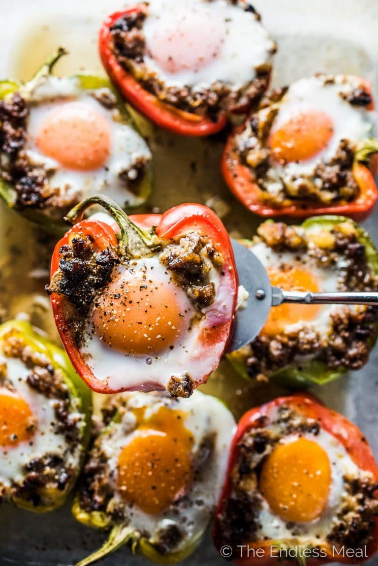 Want an easy and delicious, make-ahead brunch recipe? Try these Egg and Sausage Stuffed Peppers. They are amazing. The bell peppers are first stuffed with an onion, potato, and sausage hash. Crack an egg into the hash and bake them in your oven and breakfast is ready. They're a healthy gluten-free + paleo + Whole30 recipe you will love! | theendlessmeal.com | #breakfast #brunch #christmasbreakfast #makeaheadbreakfast #sausage #eggs #whole30recipes #paleorecipes #healthybreakfast