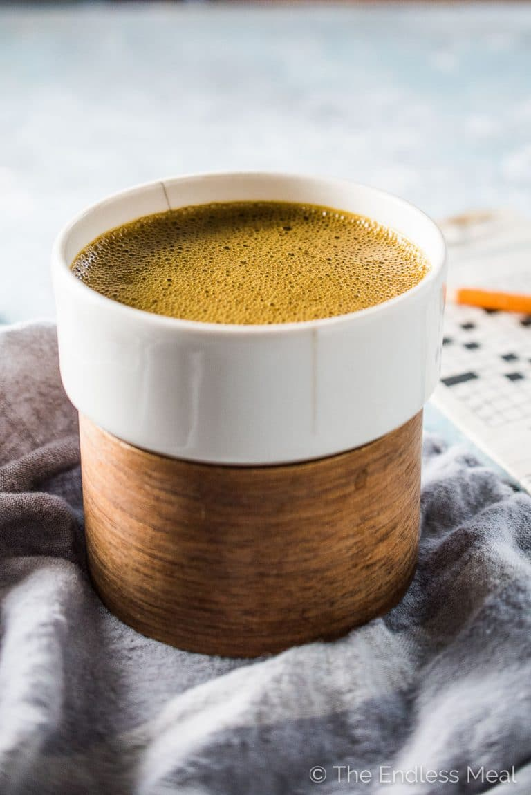 This delicious Coconut Turmeric Latte is the ultimate healthy indulgence. It tastes like a creamy dessert coffee but is so good for you. Don't worry, even though you don't taste the turmeric, you still get all of its health benefits. | theendlessmeal.com | #turmeric #turmericlatte #latte #dairyfree #veganrecipes #whole30 #bulletproof