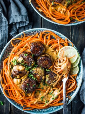 Thai Chicken Curry Meatballs are served over carrot noodles with coconut satay sauce. They are a crazy delicious and healthy dinner recipe that won't leave you feeling like you're missing out. Go ahead, help yourself to seconds!   theendlessmeal.com