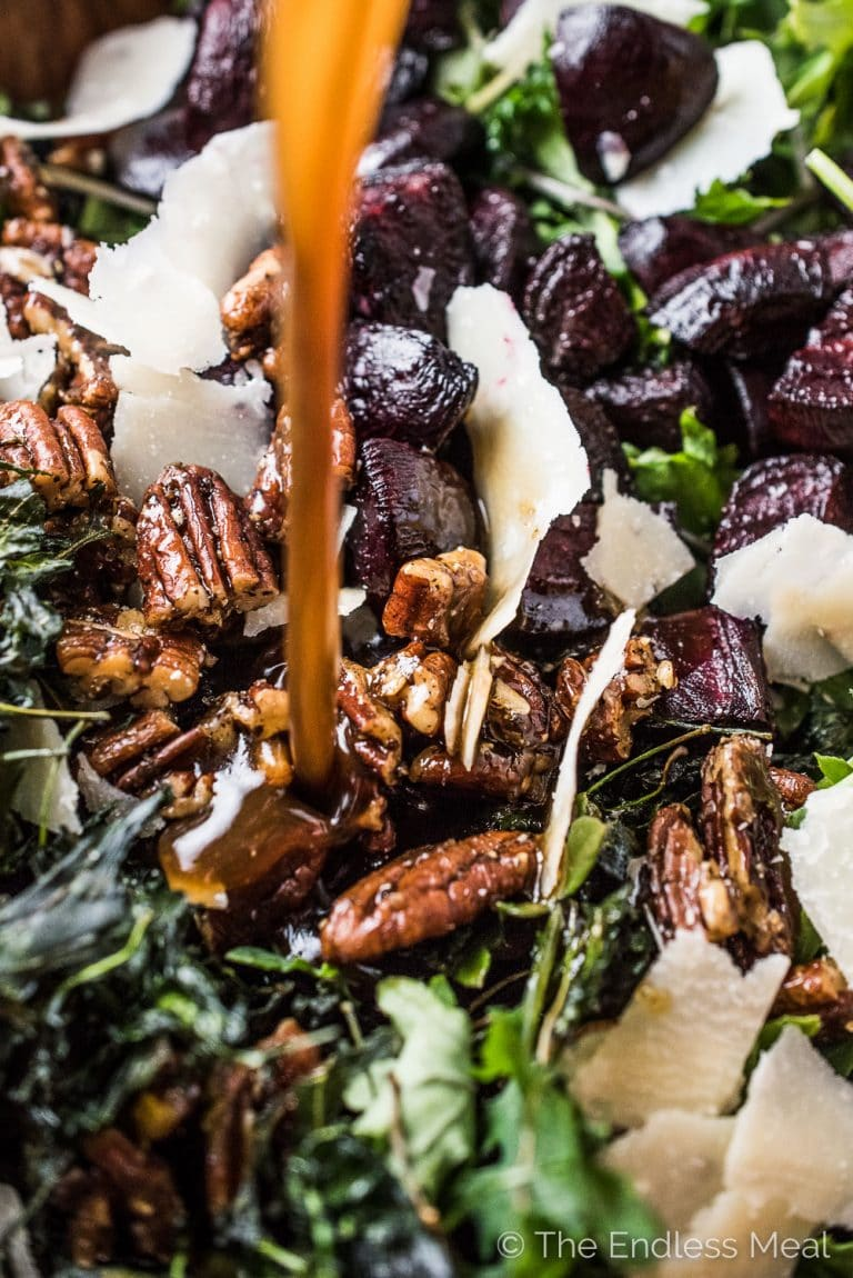 This crazy delicious Crispy Kale Salad is the most asked for kale salad around our house. It's made with both raw kale and homemade kale chips, which gives the salad tons of awesome texture. It's our favorite! | theendlessmeal.com | #salad #kale #kalesalad #saladrecipes #kalerecipes #healtyrecipes